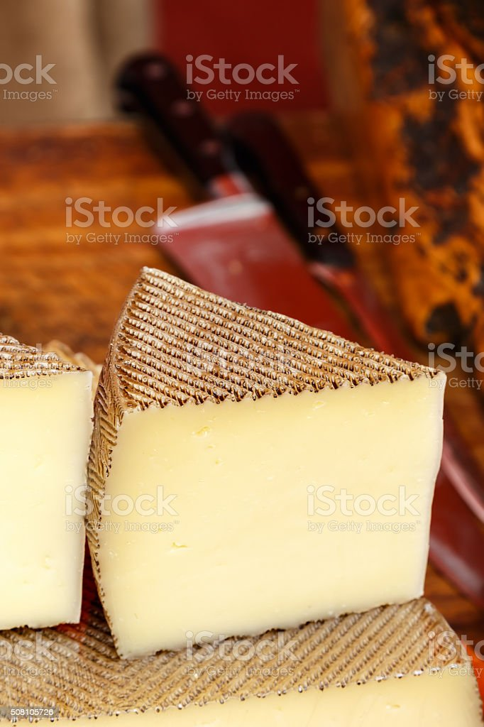Wedge of Manchego cheese. stock photo