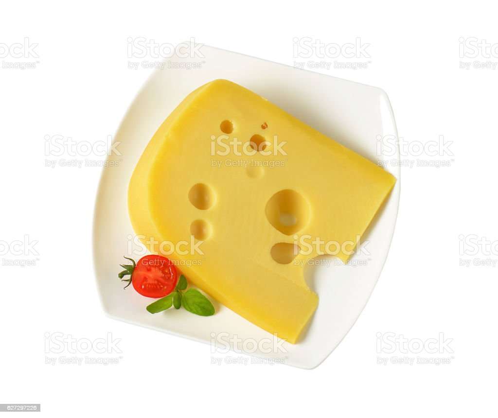 wedge of yellow cheese with eyes stock photo
