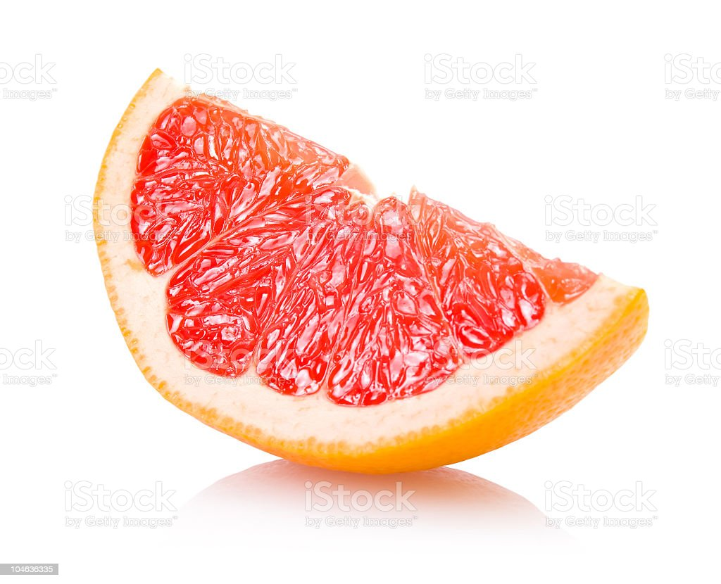 A wedge slice of fresh grapefruit stock photo