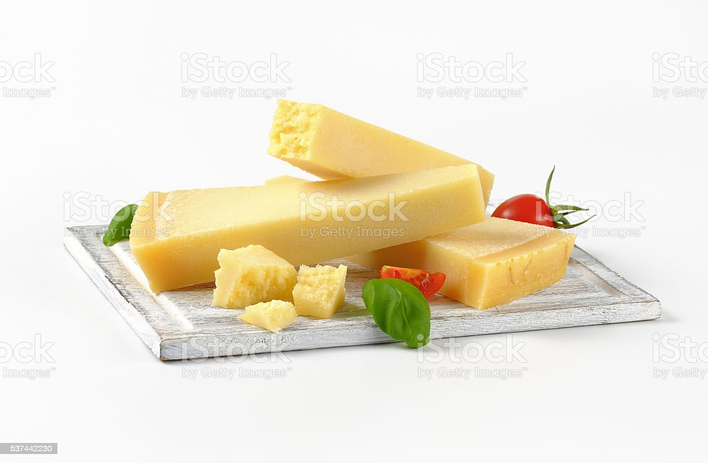 wedges of parmesan cheese stock photo