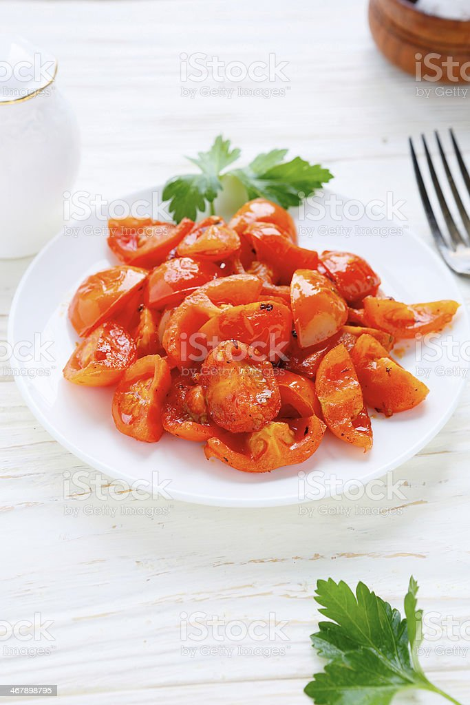wedges of roasted cherry tomatoes stock photo