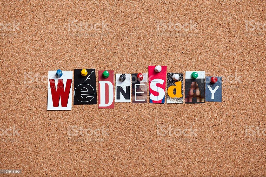 Wednesday pinned on bulletin cork board stock photo