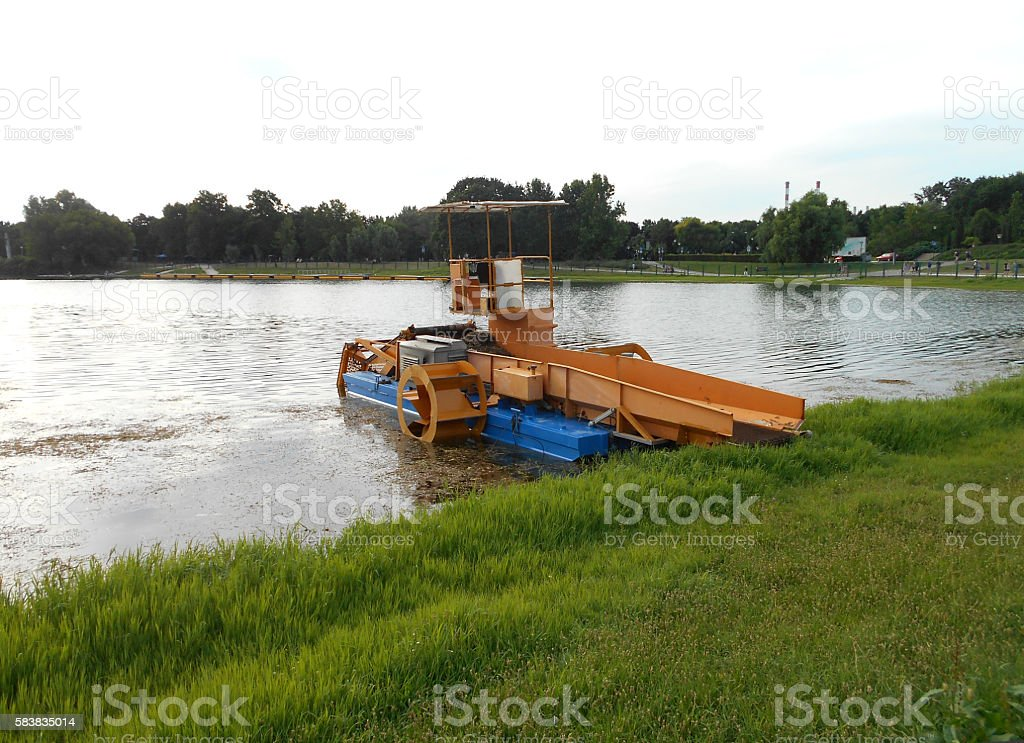 Weed and Algae Removal Boat stock photo