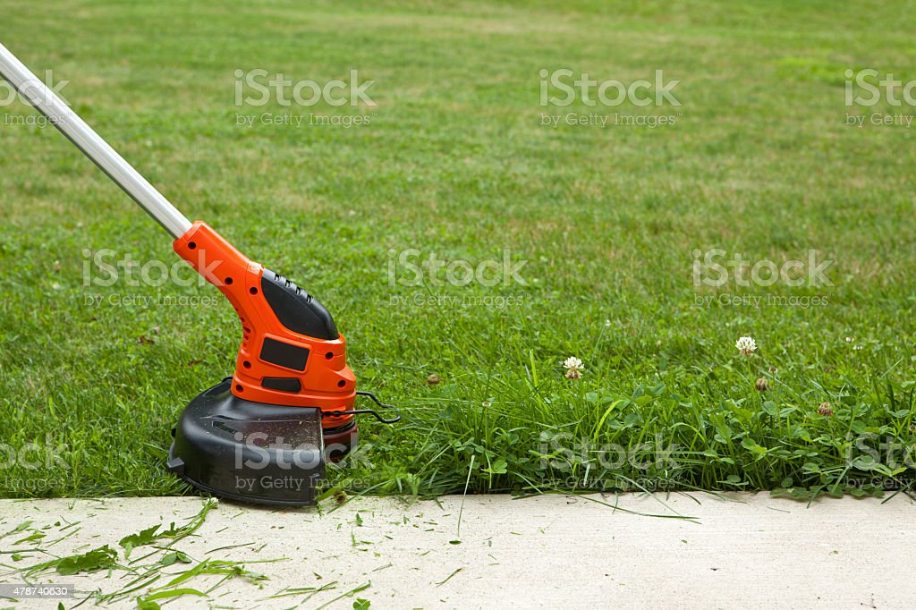 Weed Trimmer Cutting Grass stock photo