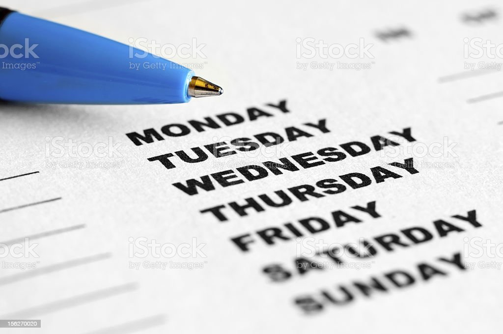 Weekday checklist with blue pen royalty-free stock photo