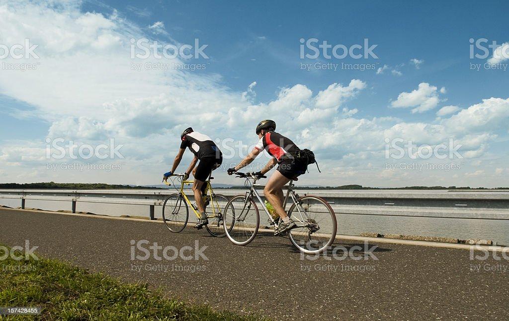 Weekend biking couple with blue sky stock photo