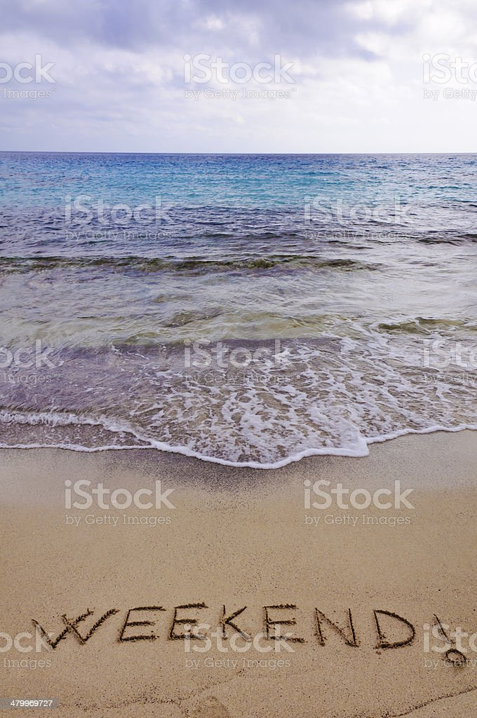 Weekend ! written in sand, on a beautiful beach stock photo