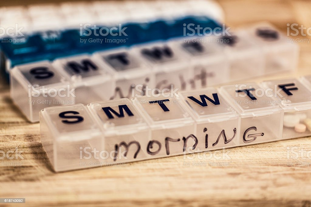Weekly Morning and Night Seven Day Plastic Pill Boxes stock photo