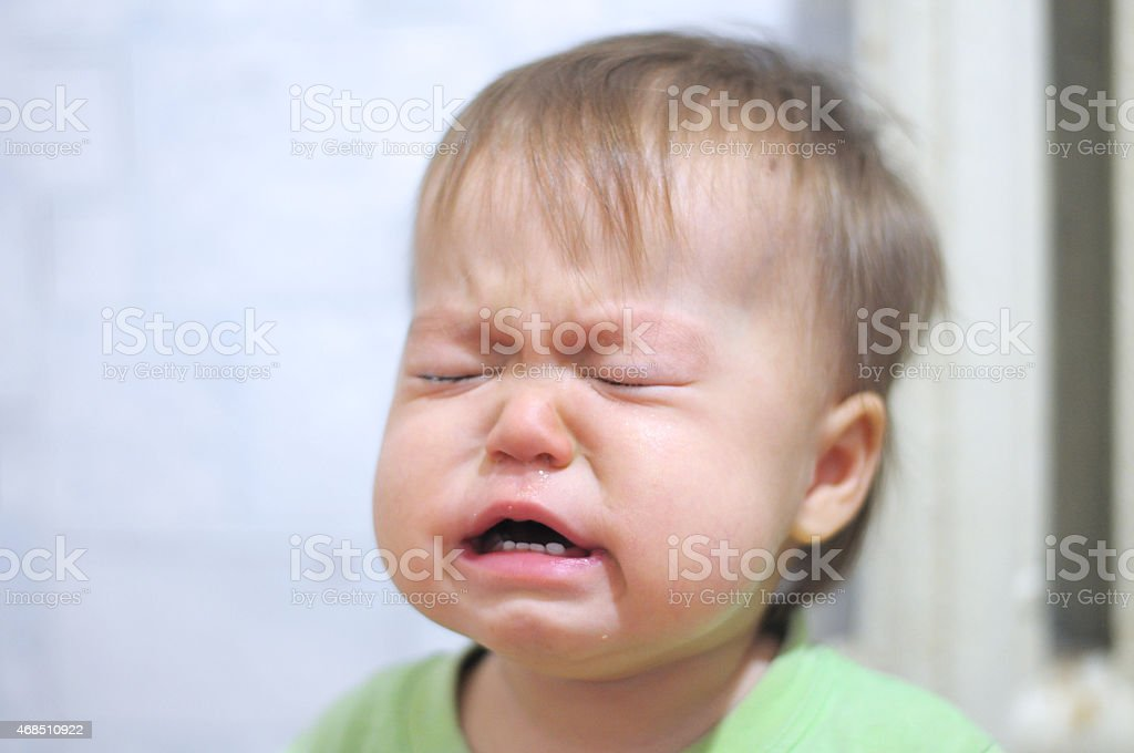 weeping baby stock photo