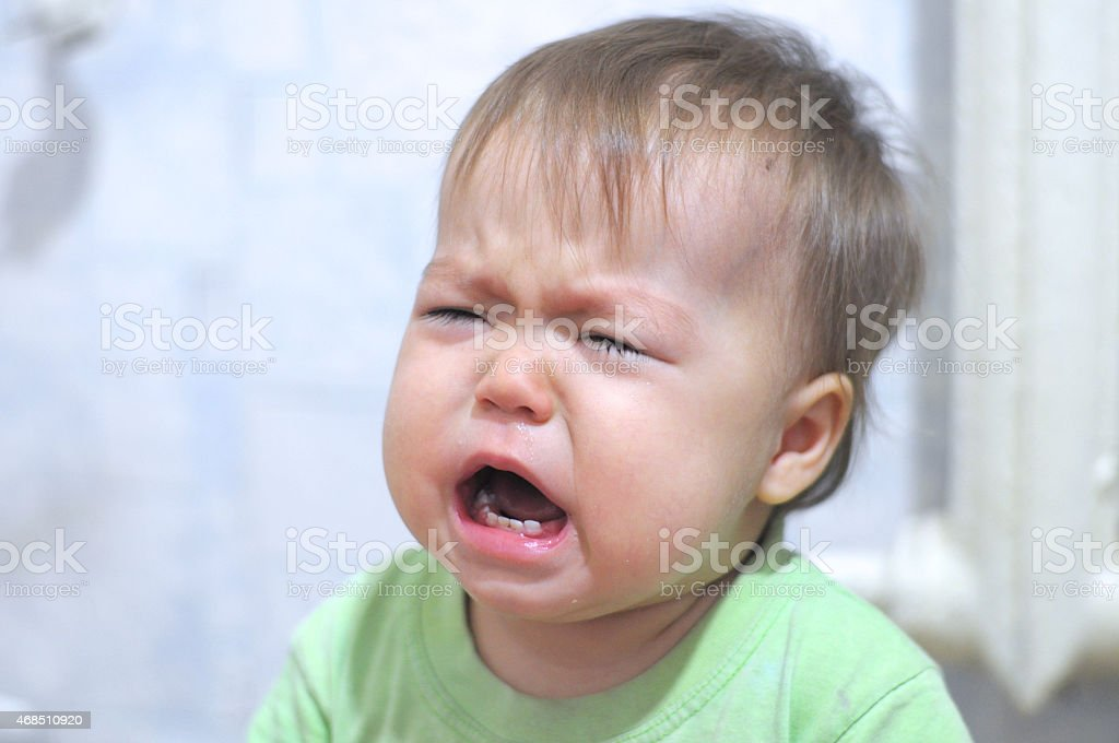 weeping baby portrait stock photo