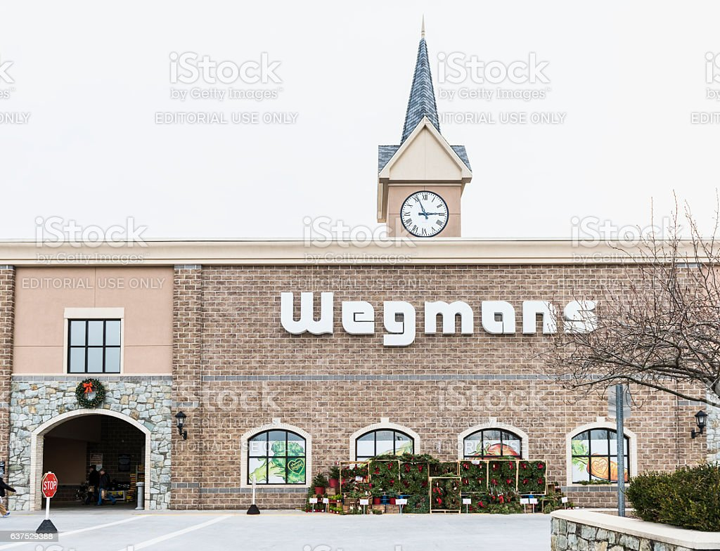 Wegmans grocery store facade and sign with people stock photo