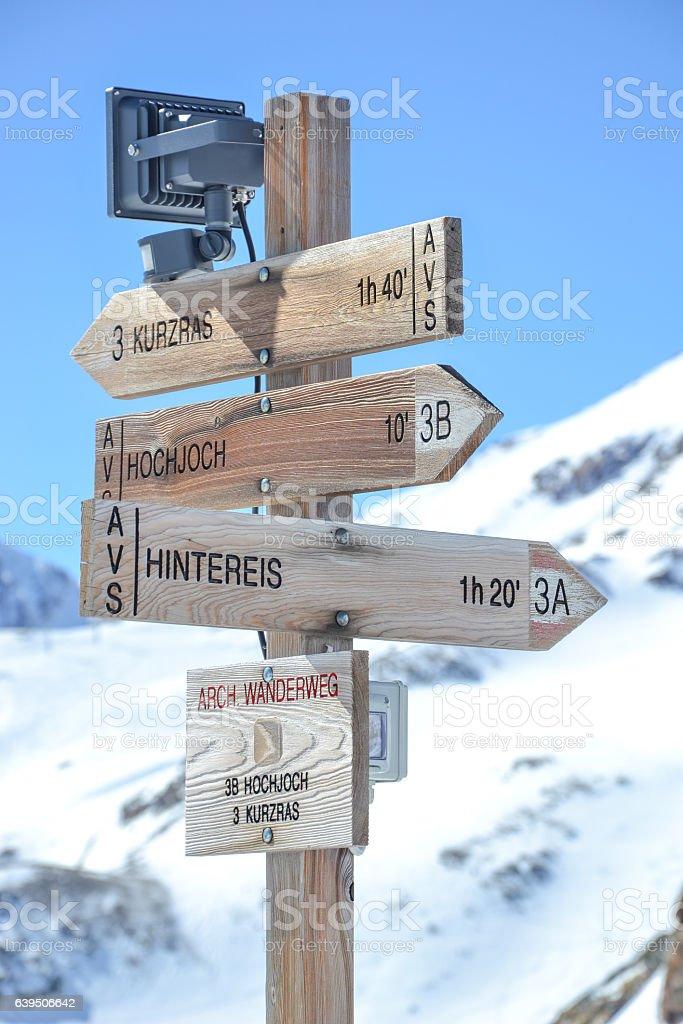 Wegweiser - snowy mountain peaks on glacier val senales stock photo