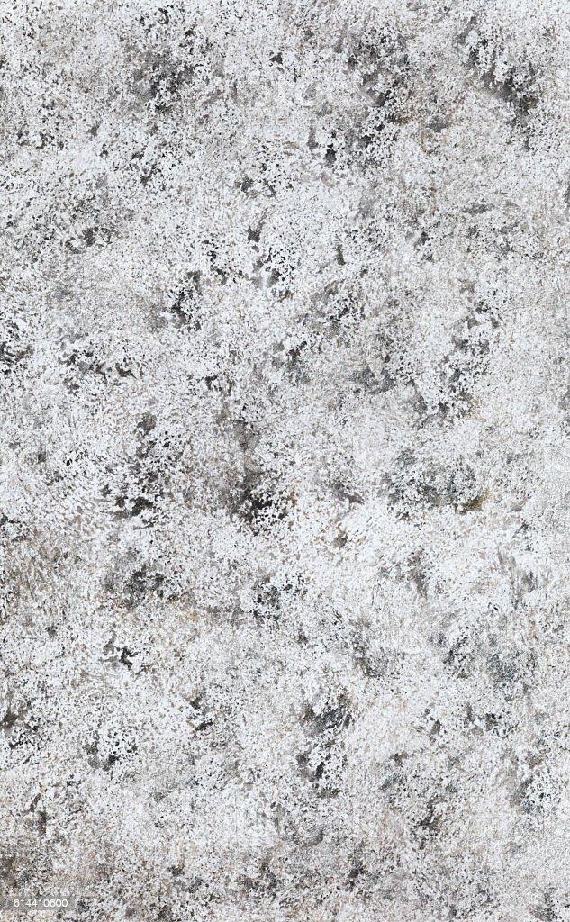 Weiße Wand mit schwarzen Flecken. stock photo