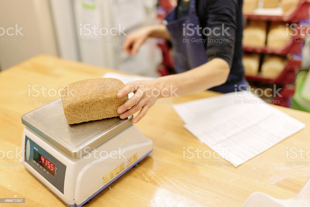 Weighing a wholemeal loaf royalty-free stock photo