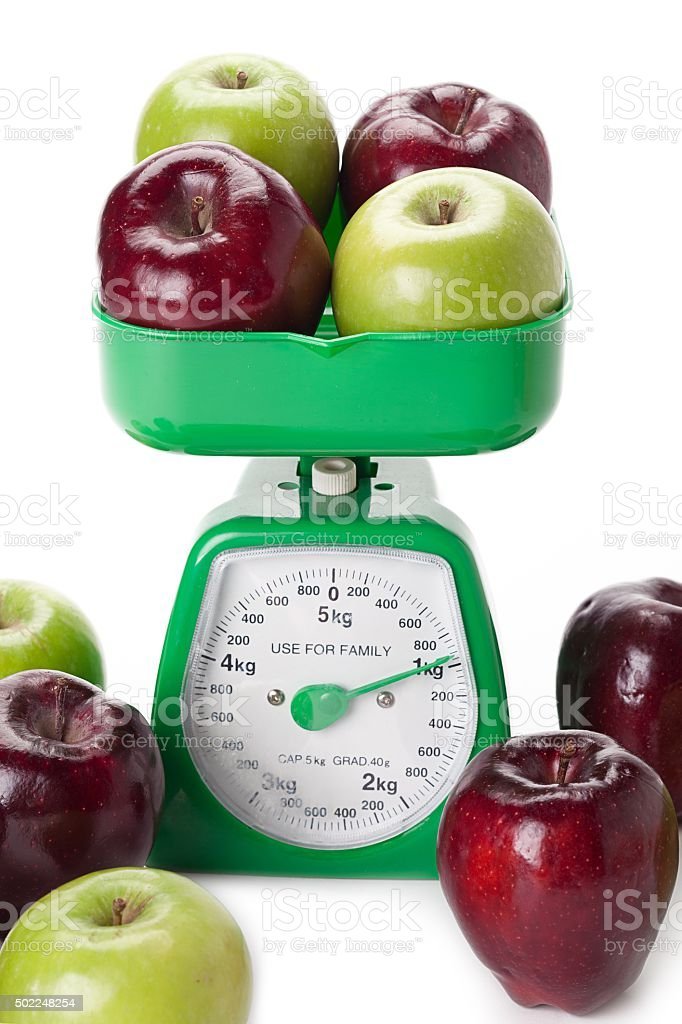 weighing apples stock photo