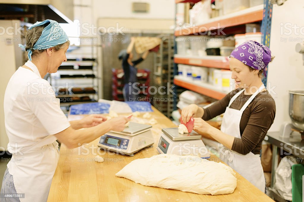 Weighing bread dough stock photo