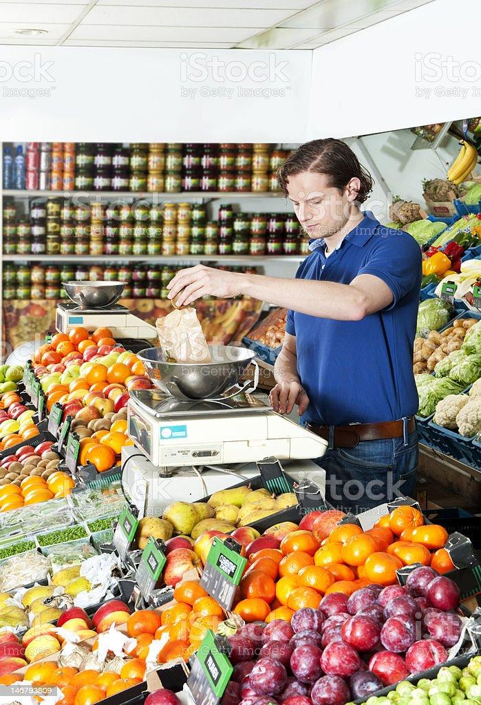Weighing fresh fruits royalty-free stock photo