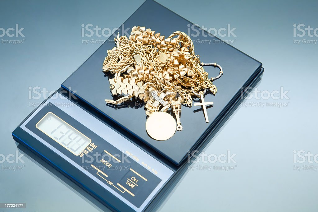 weighing gold stock photo