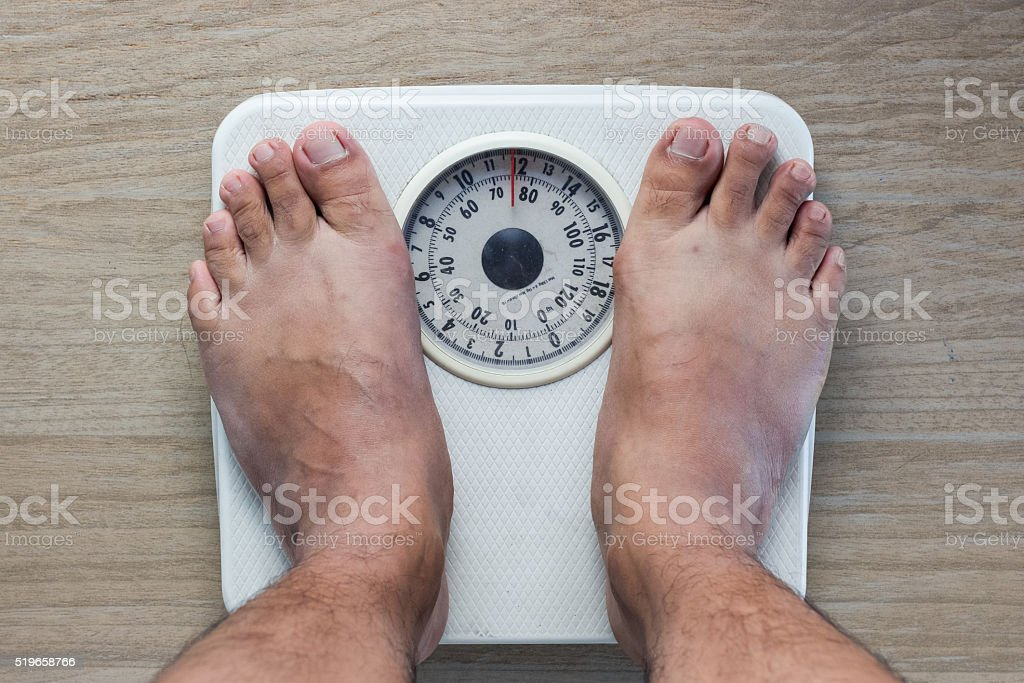 Weighing on analog Weight stock photo
