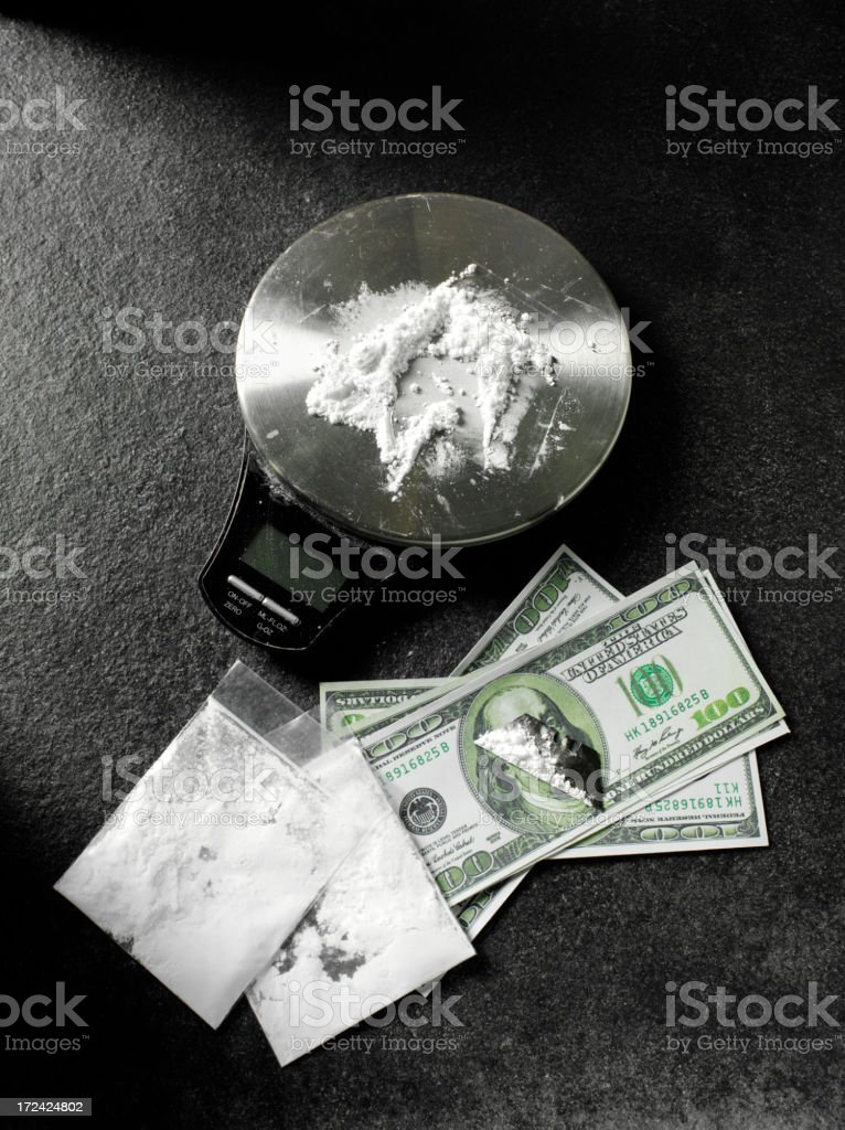 Weighing Scales with Drugs and American Dollars royalty-free stock photo