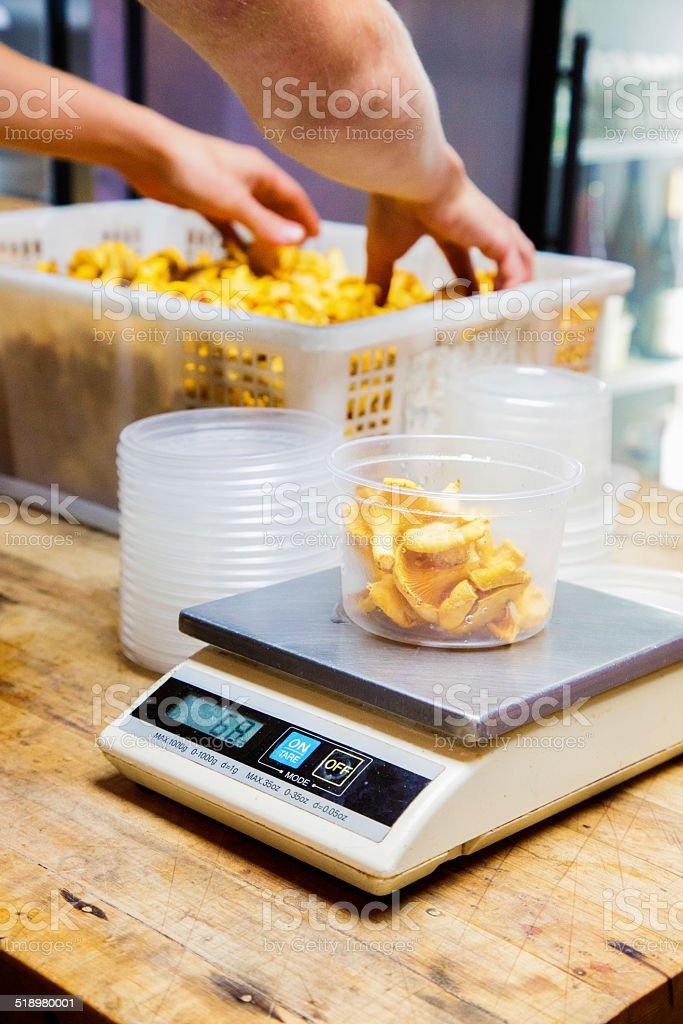 Weighing servings of chanterelles mushrooms stock photo