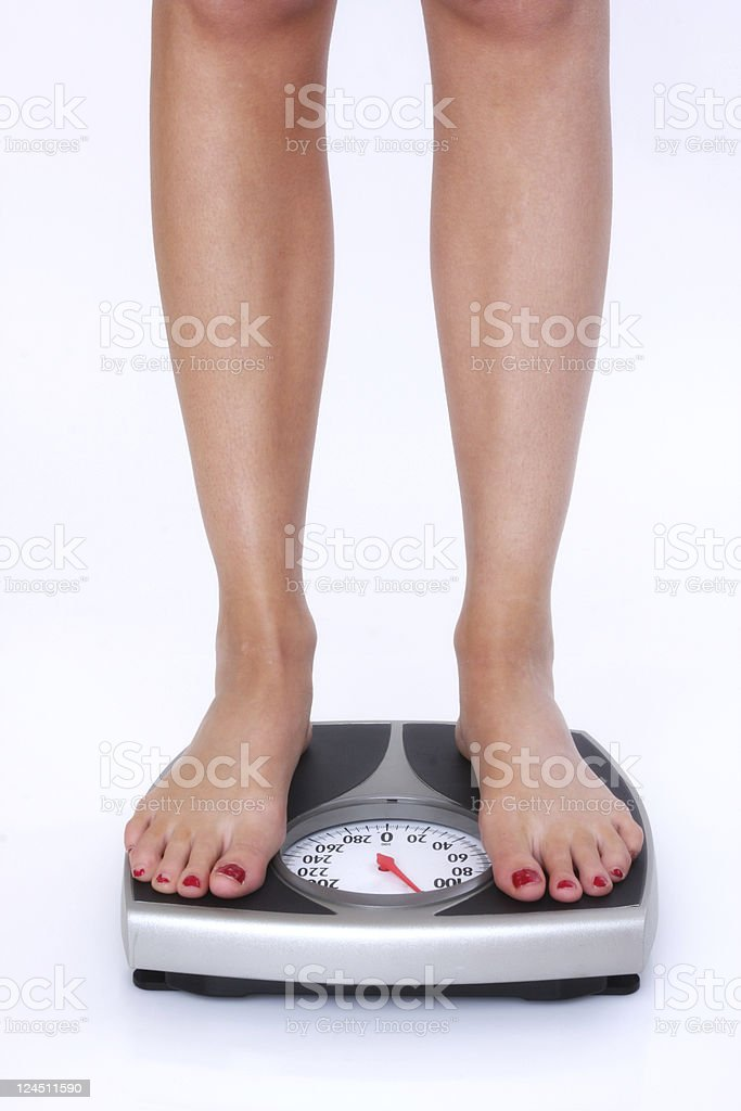 weighing the loss royalty-free stock photo