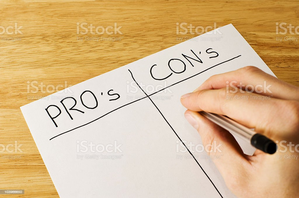 Weighing Up The Pro's And Con's stock photo