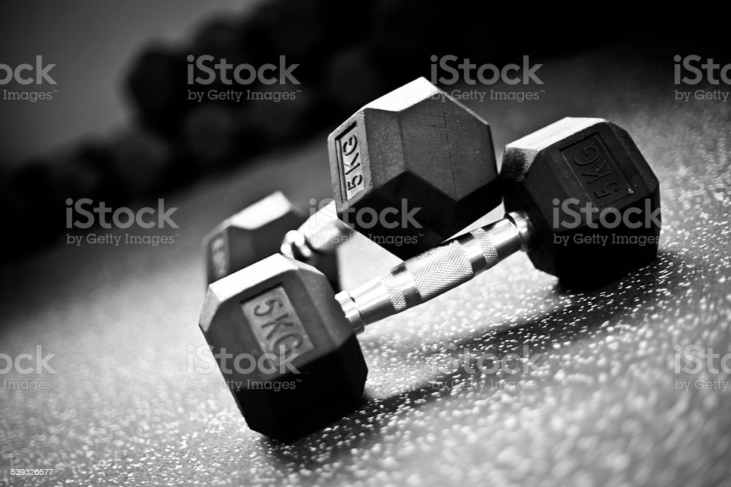 Weight lifting-Dumbells in a crossfit gym stock photo