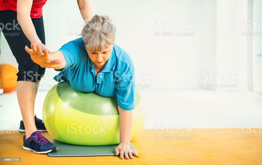 Weight loss exercise in a gym. stock photo