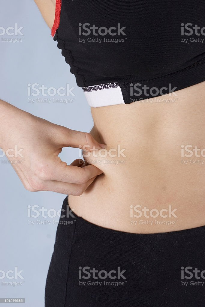 Weight loss  -pinch an inch royalty-free stock photo