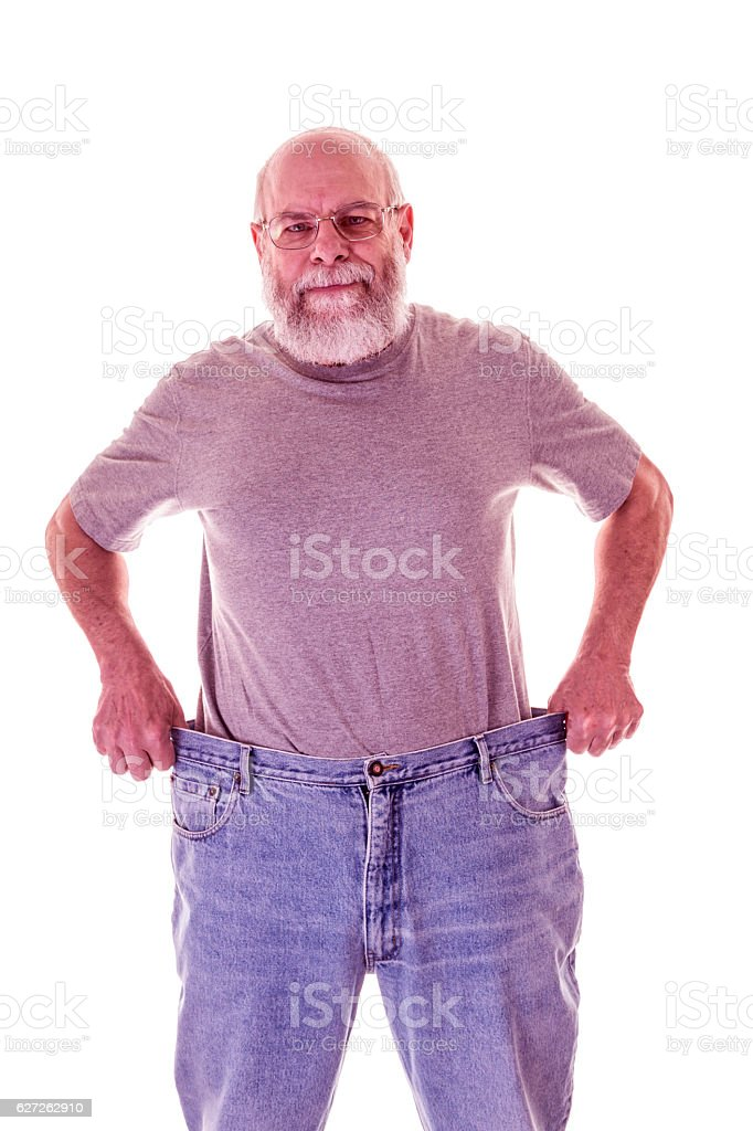 Weight Loss Senior Adult Man Showing Off Large Old Jeans stock photo