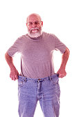 Weight Loss Senior Adult Man Showing Off Large Old Jeans