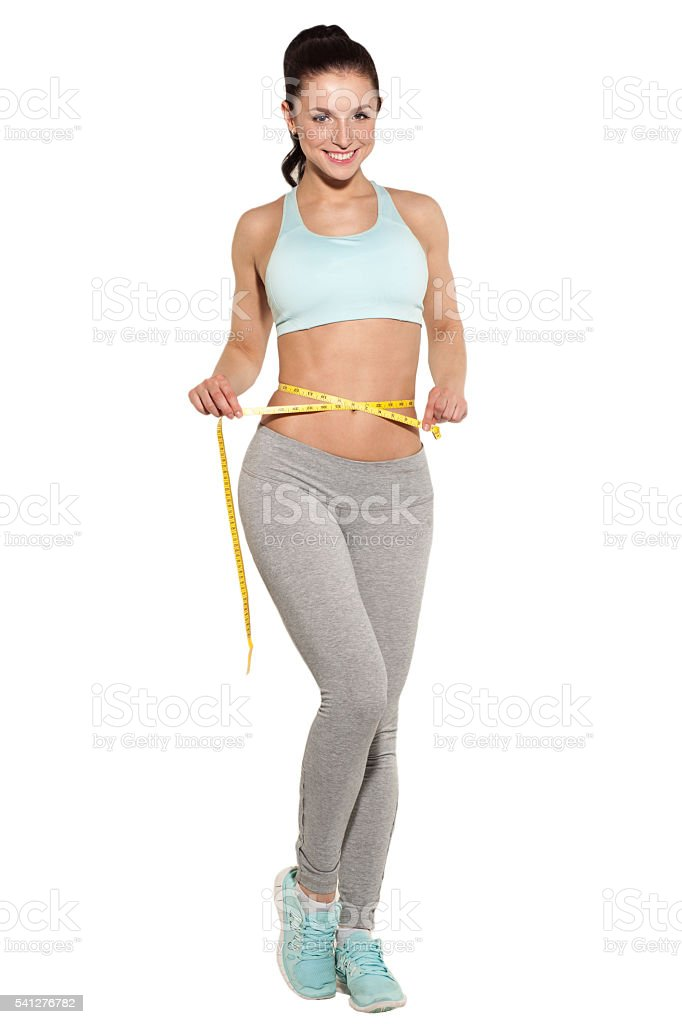 weight loss, sports girl measuring her waist, training in gym stock photo