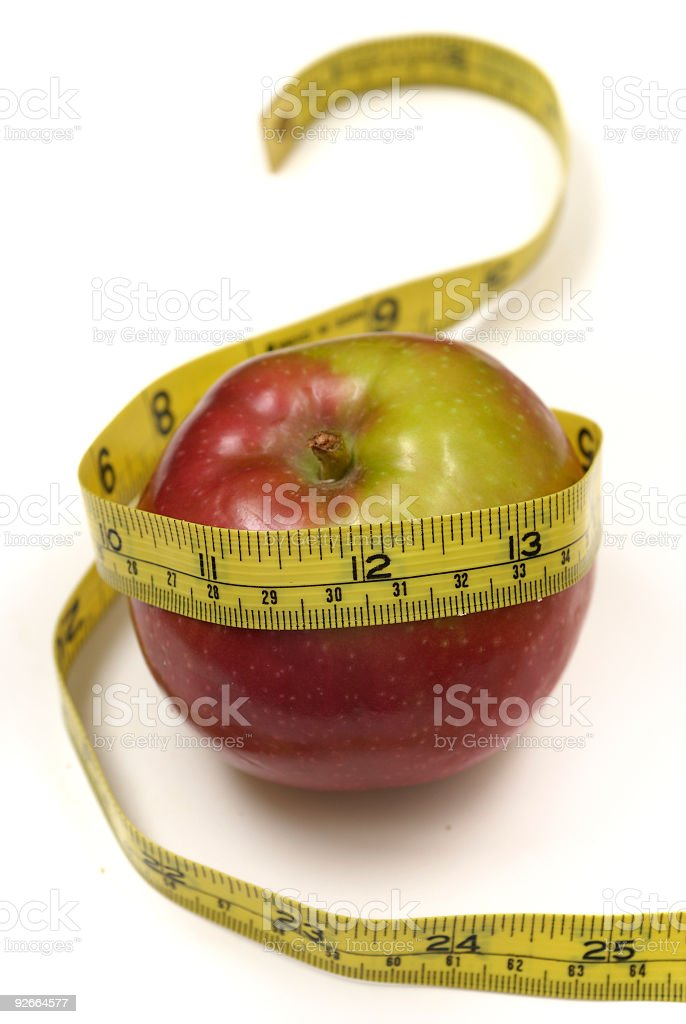 Weight loss with an apple - Vertical stock photo