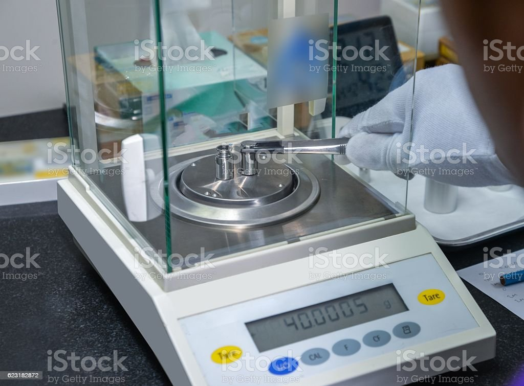 weight measure on the electronic balance in a laboratory stock photo