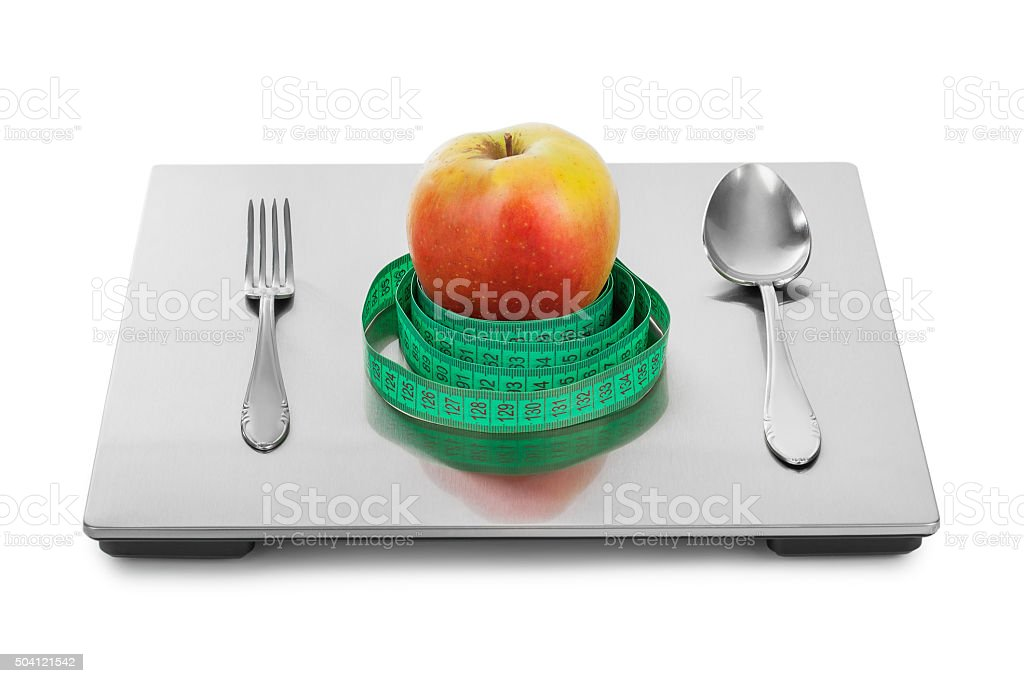 Weight scale and fruits stock photo