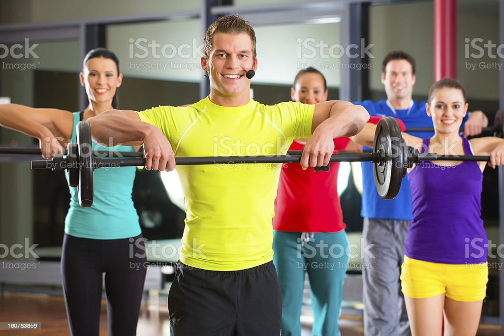 weight training in the gym with dumbbells royalty-free stock photo