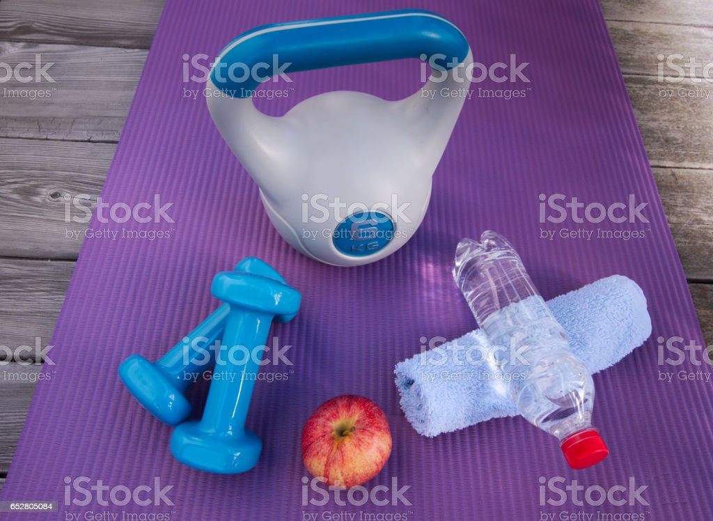 Weight training with a kettle bell and dumbbells, than a healthy snack and lots of water stock photo