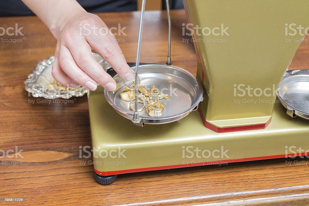 Weighting gold jewelry stock photo