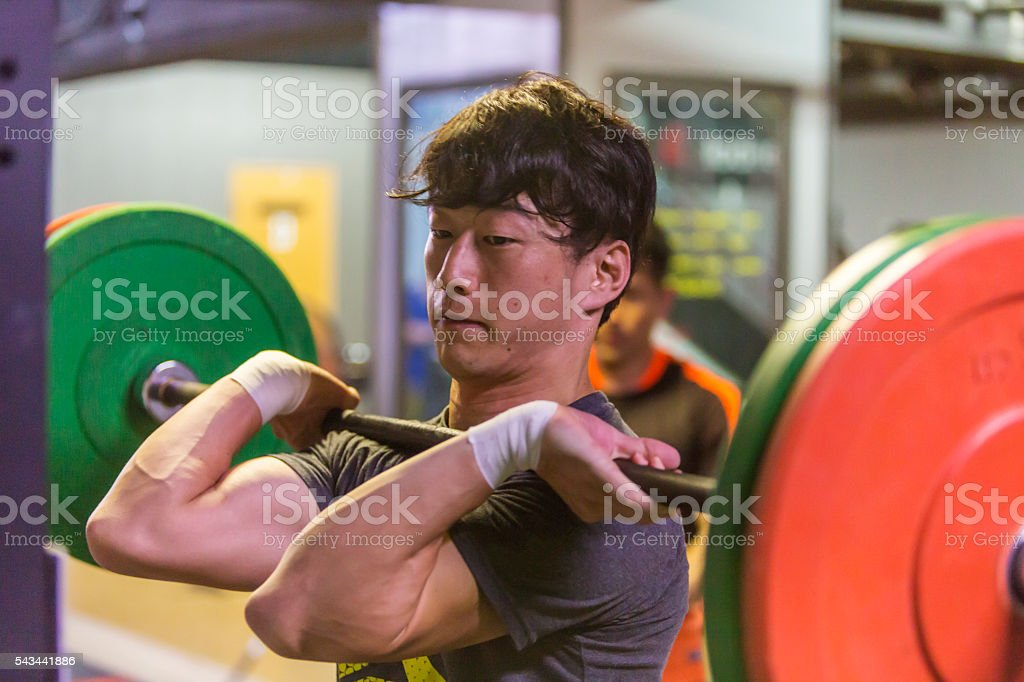 Weightlifter Concentration and Effort in a Cross Training Gym stock photo