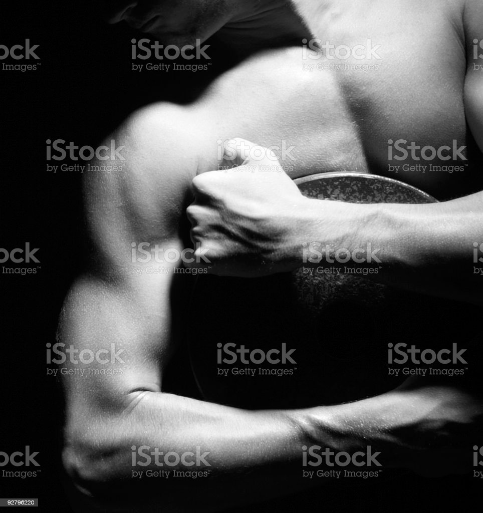 Weightlifter holding weight plate royalty-free stock photo