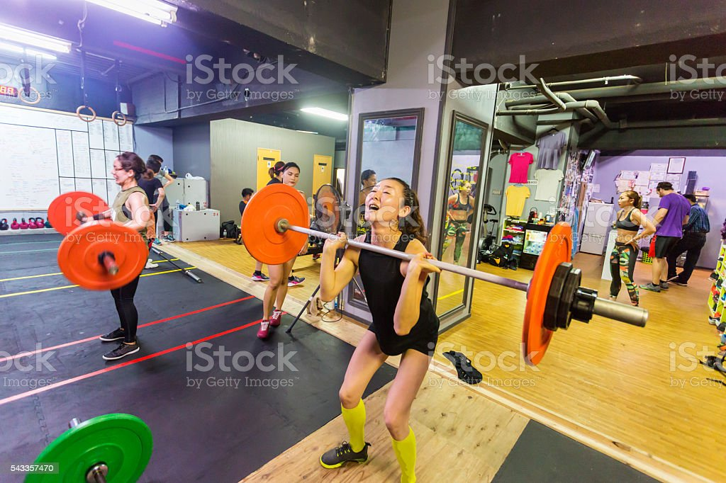 Weightlifters Of Different Abilities in a Cross Training Gym stock photo