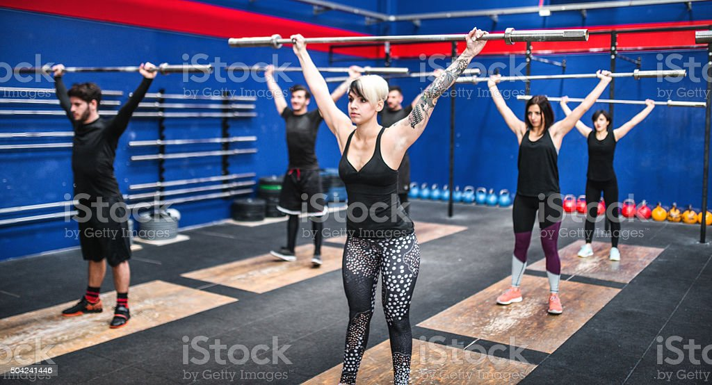 weightlifting class togetherness stock photo