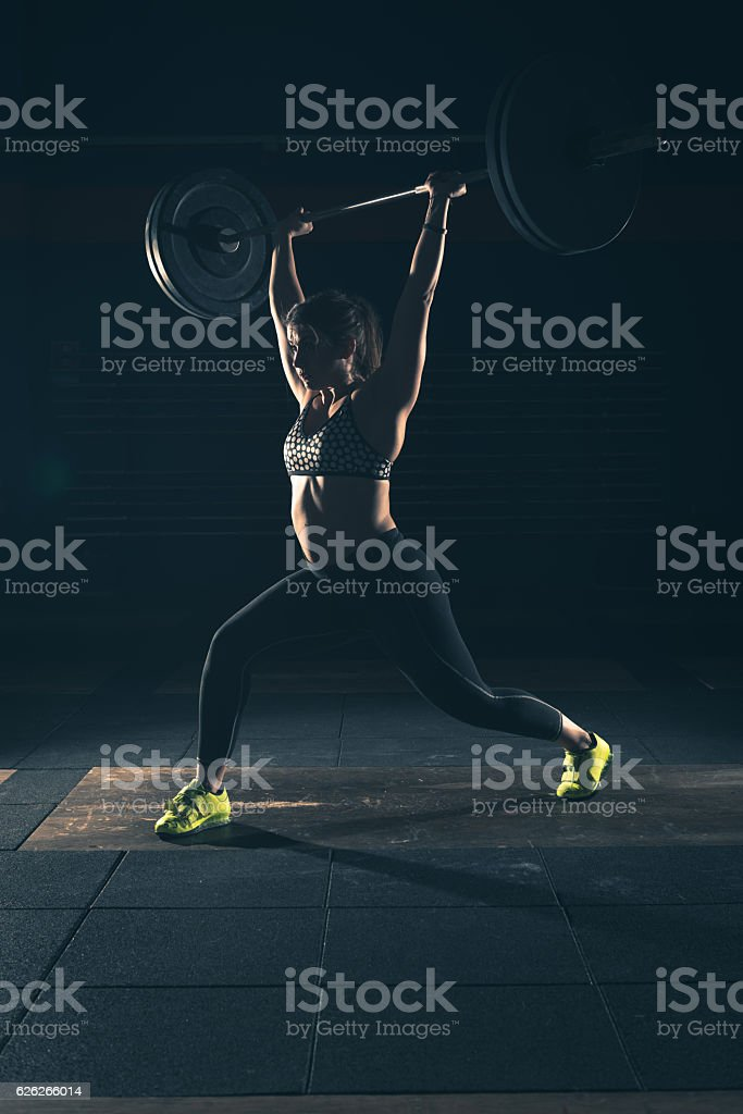 weightlifting strong woman on a gym stock photo