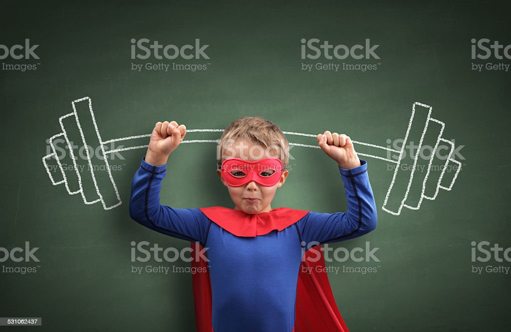 Weightlifting superhero boy stock photo