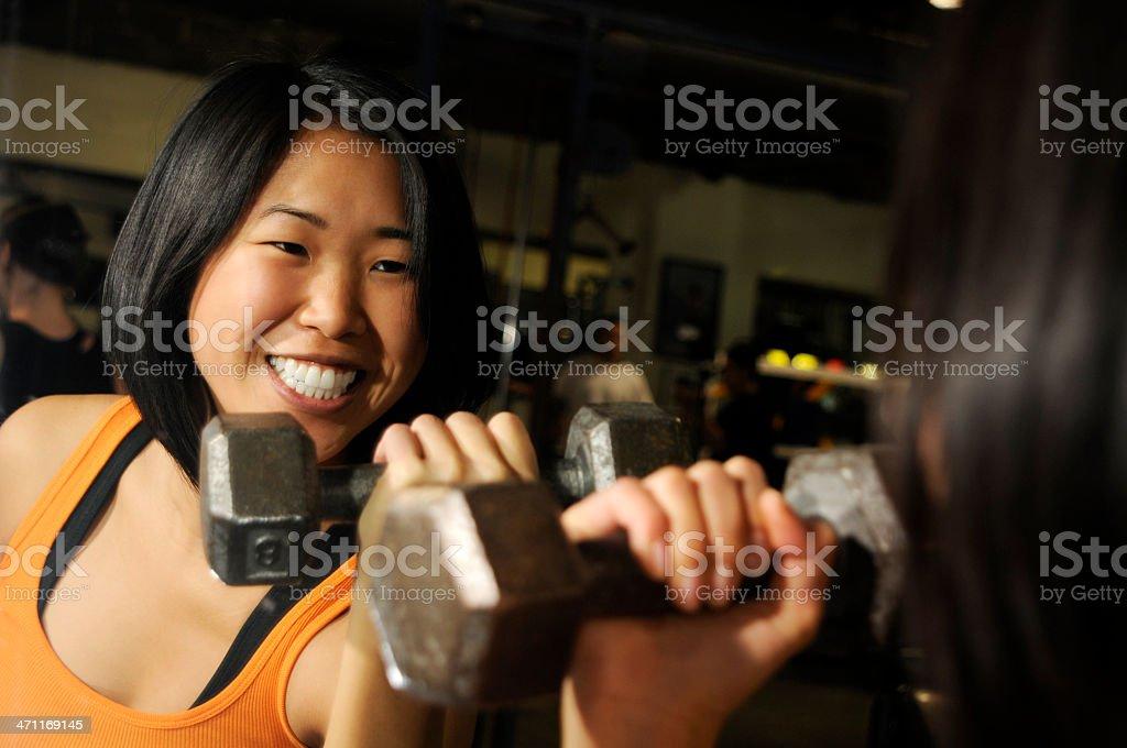 Weight-lifting woman stock photo