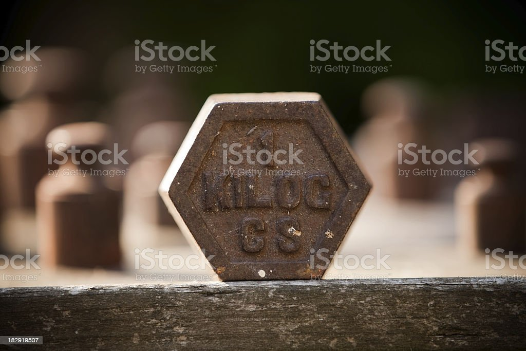 Weights on table in evening light stock photo
