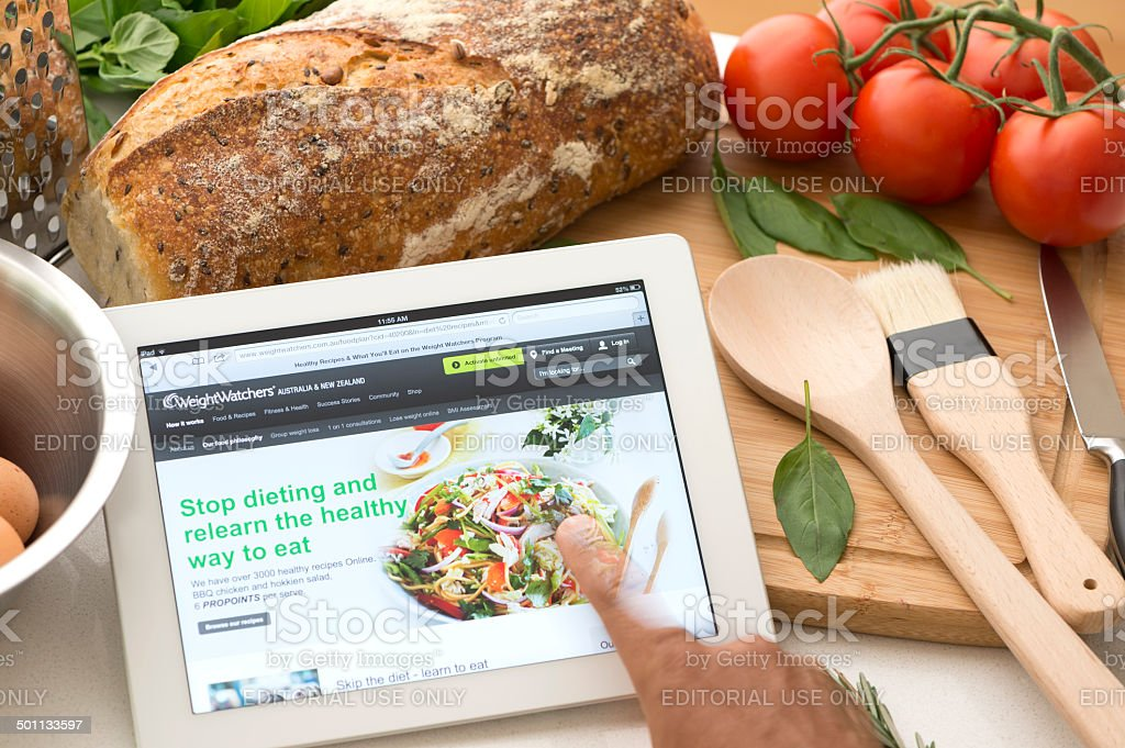 weightwatchers.com website on a digital tablet in a kitchen stock photo
