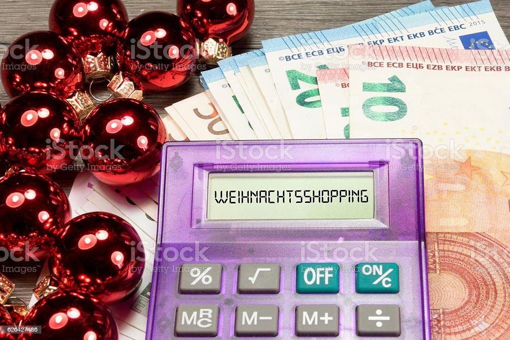 Weihnachtseinkäufe, Geld und Taschenrechner stock photo