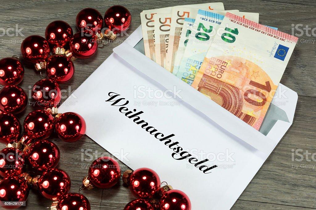 Weihnachtsgeld im Briefumschlag stock photo